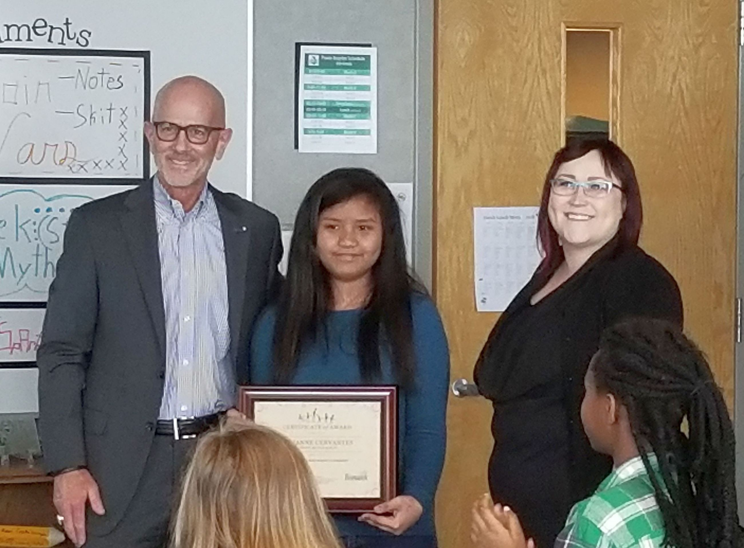 HRC Essay Contest Award recipient J. Cervantes, Horizon Middle School, Mayor Seminary, Krista Rausch, chair, Human Relations Committee